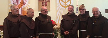 A portrait of five friars from Sts. Francis and  Clare Parish