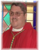 Image of Bishop Frank in red vestments and bishop cap